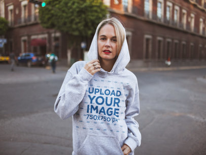 Mockup of a Casual Woman Wearing a Heathered Pullover Hoodie 23986