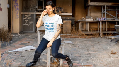 T-Shirt Video Maker Featuring an Edgy Woman in an Abandoned Workshop 13378