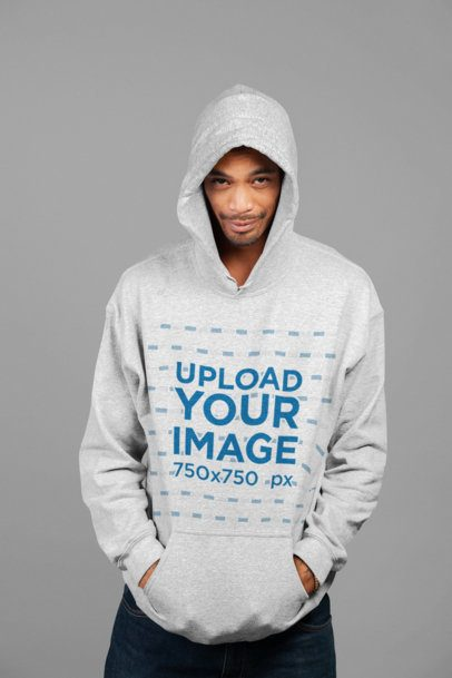 Mockup of a Man Wearing a Heathered Hoodie with His Hand in its Pockets 23948