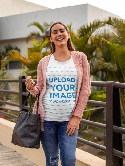 Tee Mockup Featuring a Pregnant Woman Carrying a Bag over a Small Bridge 26659