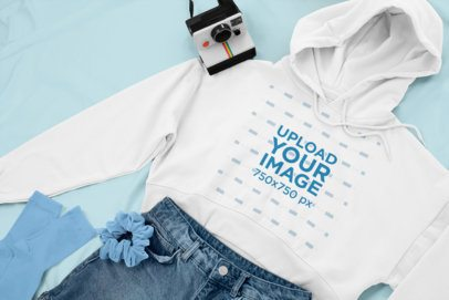 Pullover Hoodie Mockup of a Woman's Outfit Lying Next to a Polaroid 26332