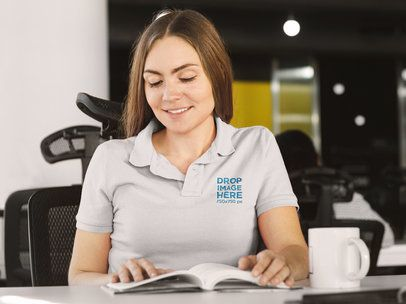 Polo Shirt Mockup of a Woman Reading a Book at the Office a8203