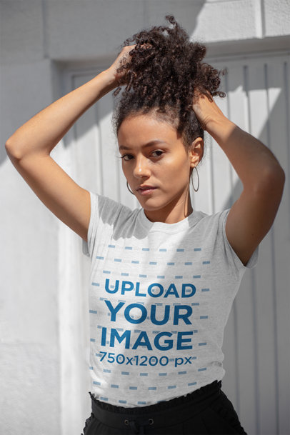 T-Shirt Mockup Featuring a Beautiful Young Woman Playing with Her Hair 23967