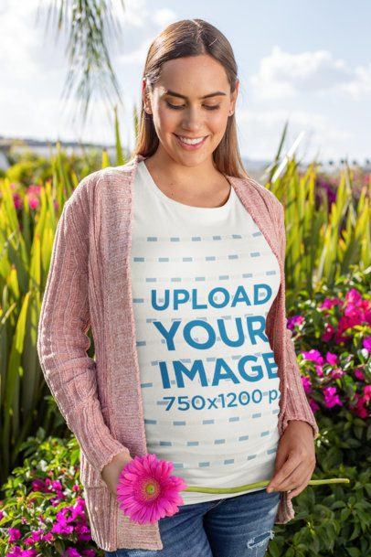 T-Shirt Mockup of a Pregnant Woman in a Flowery Scenario 26685