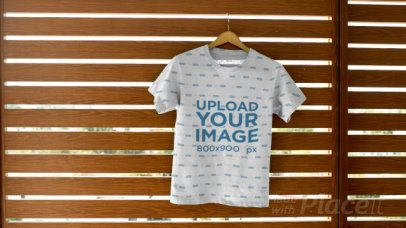 Tee Video Maker Featuring a T-Shirt Hanging on a Wall 13859