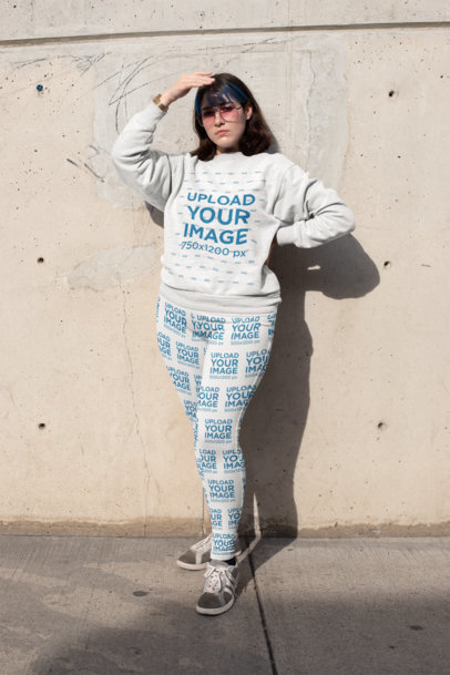 Mockup of a Woman Wearing a Plus Size Sweatshirt and Leggings Covering Her Face from the Sun 25001