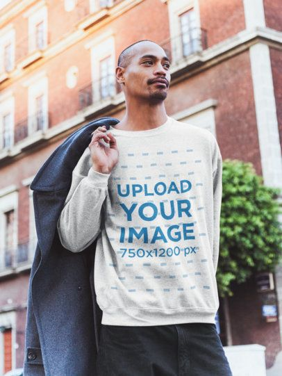 Heather Sweatshirt Mockup of a Man Holding a Coat at the City 24001