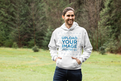 Pullover Hoodie Mockup of a Smiling Man in an Open Green Area 25103