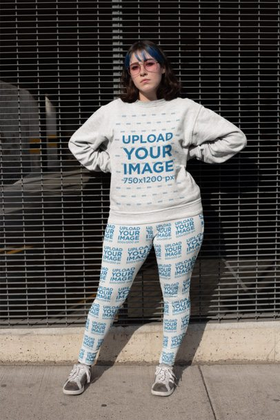 Mockup of an Audacious Woman with Blue Bangs Wearing a Plus Size Sweatshirt and Leggings 25002