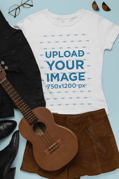 Outfit Mockup Featuring a T-Shirt Next to a Skirt and a Ukulele 26397