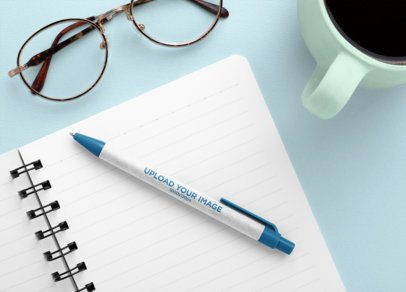 Mockup of an Eco-Friendly Pen on a Notepad 23532