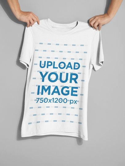 Mockup of Two Hands Holding a T-Shirt 26737