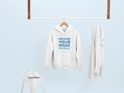 Mockup of a Hoodie Hanging With Only White Clothes 26891