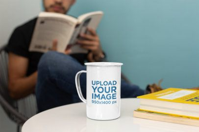 21 Oz Enamel Mockup Featuring a Man Reading in the Back 26933