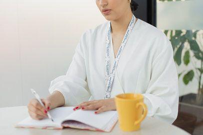 Lanyard Mockup of a Woman Taking Notes at Work 26521