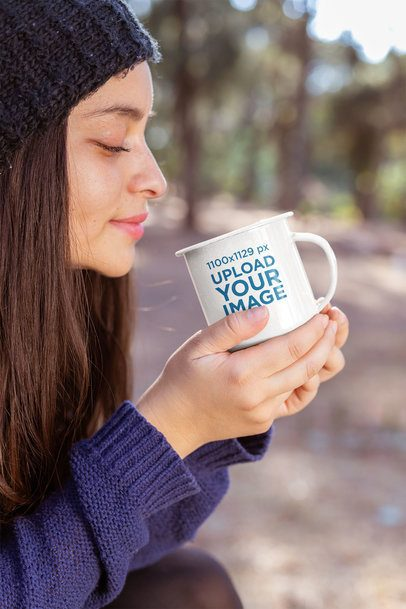 Mockup of a Young Woman Holding a 12 oz Enamel Mug in the Woods 26916