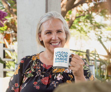 11 Oz Mug Mockup of a Senior Woman Having a Coffee 27459