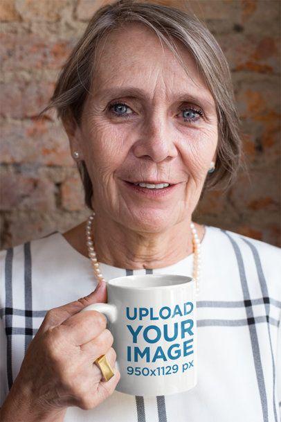 Mockup of an 11oz Mug in the Hand of an Adorable Grandma 27456