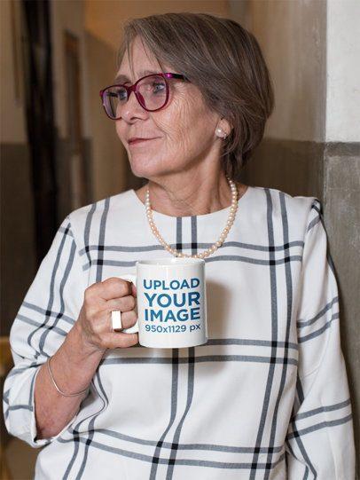 11 Oz Coffee Mug Mockup of a Fashionable Senior Woman Leaning against a Wall 27453