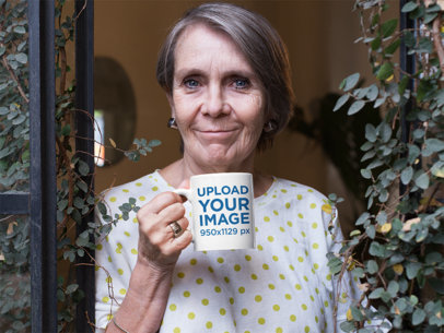 11 Oz Coffee Mug Mockup of a Lovely Grandma Standing at Her Window 27440