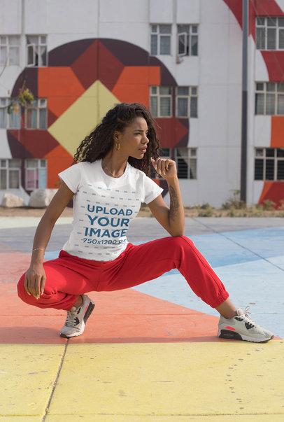 Tee Mockup of a Sporty Woman Posing in a Colorful Urban Scenario 27344
