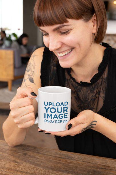 Mockup of a Smiling Tattooed Woman Holding an 11oz Coffee Mug 27233