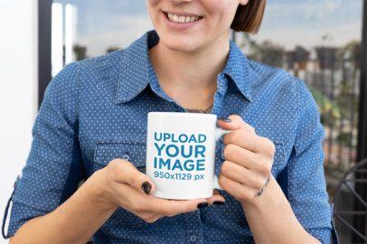 Mockup of a Smiling Woman with Dark Nails Holding an 11 Oz Mug 27237