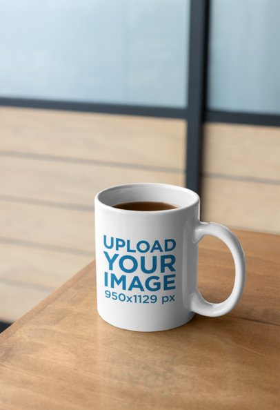 Mockup of an 11 Oz Coffee Mug on a Wooden Table 27238