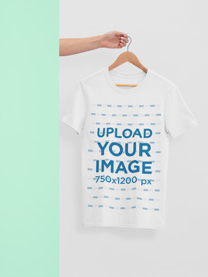 Mockup of a T-Shirt Hanging from a Hand 26885