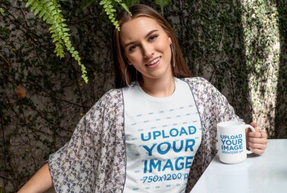 15 oz Mug Mockup of a Woman Wearing a T-Shirt Against a Wall Covered in Leaves 27508
