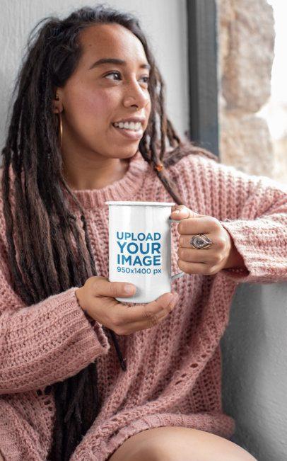 Mockup of a Woman Holding a 21 oz Enamel Mug and Looking through a Window 26976
