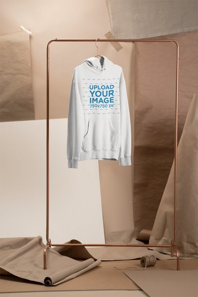 Mockup of a Hoodie Hanging at a Craft Stage 27484