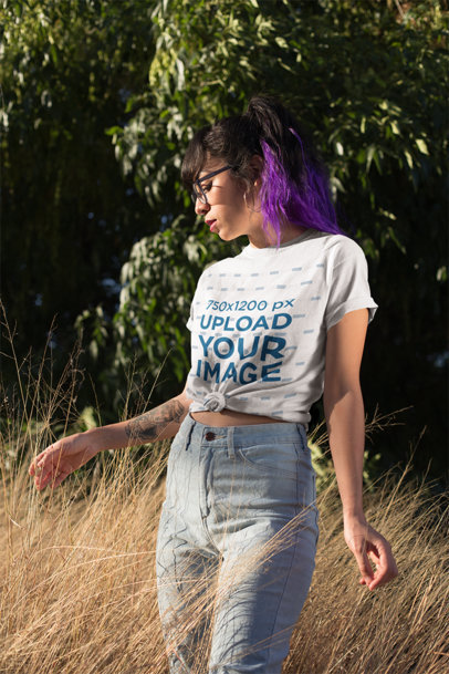 Knotted T-Shirt Mockup of a Woman Posing Between Pasture at Sunset 27060