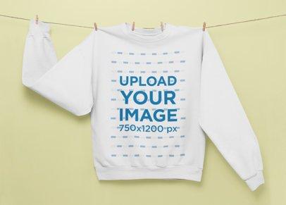 Mockup of a Crewneck Sweatshirt Hanging From a Thread 27001