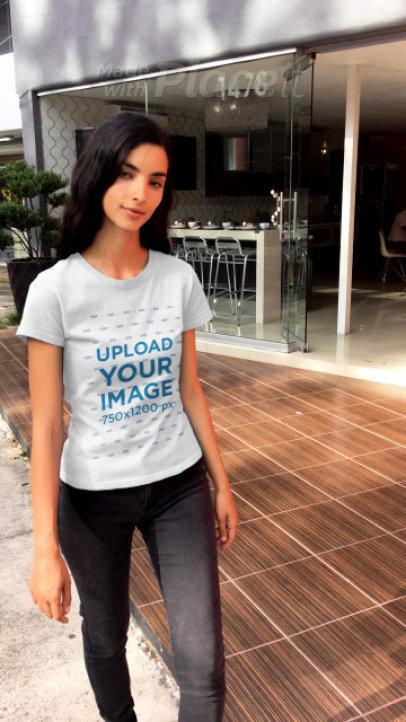 T-Shirt Video of a Slim Woman Walking Down a Street 23262