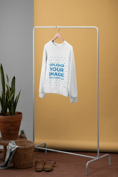 Women's Sweatshirt Mockup Featuring a Minimalistic Setting with Plants 27491