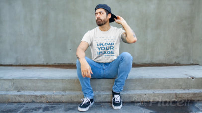 T-Shirt Video of a Bearded Man Sitting on Some Steps 12173
