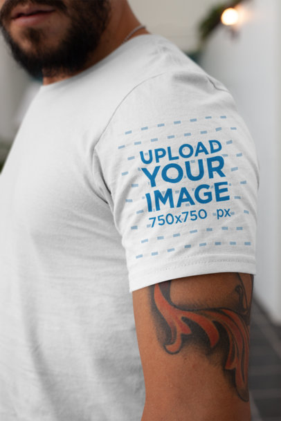 T-Shirt Sleeve Mockup Featuring a Tattooed Man 27145