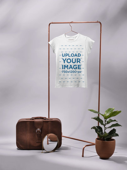 Mockup of a Shirt Hanging in a Clothing Rack in a Studio 27407
