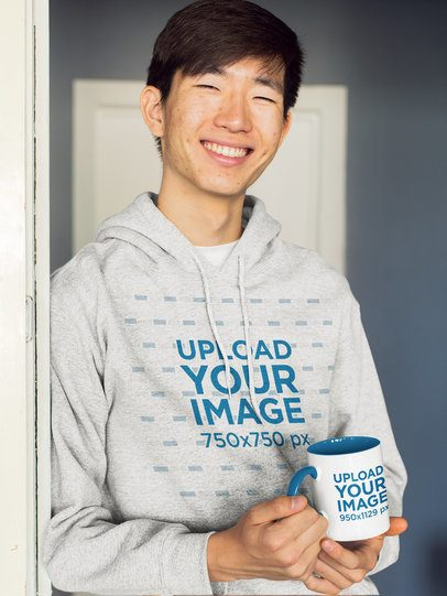 11 oz Two-Toned Coffee Mug Mockup Featuring a Smiling Man in a Hoodie 27818