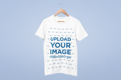 Mockup of a T-Shirt Hanging Against a Solid Background 26878