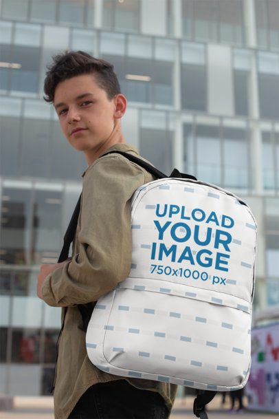 Backpack Mockup of a Teenager in Front of a Building with Crystal Windows 27704