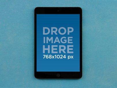 Black iPad Mini Blue Background