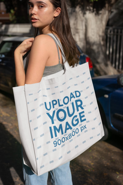 Mockup of a Young Woman Holding a Grocery Bag While Walking on the Street 27628