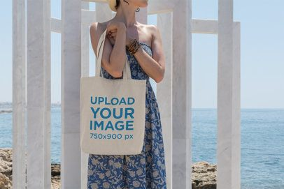 Tote Bag Mockup Featuring a Woman by the Sea 12-el
