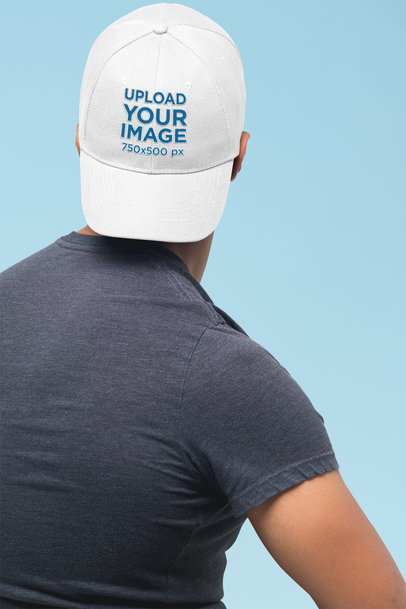 Mockup of a Man Facing the Wall Wearing a Dad Hat in a Studio 27043