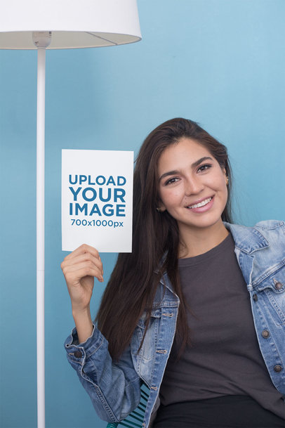 A5 Flyer Mockup Featuring a Young Woman Wearing a Denim Jacket 27356