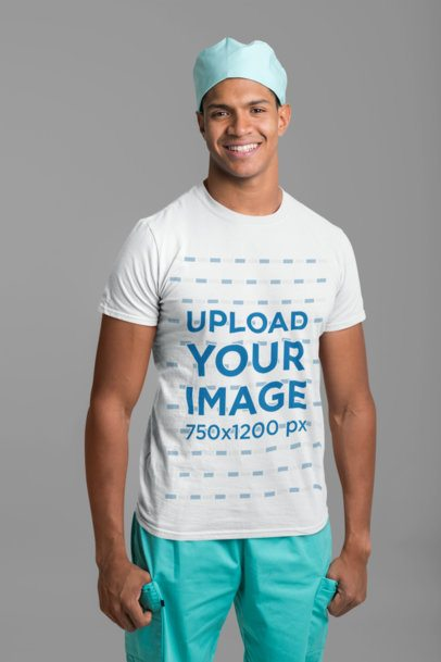 T-Shirt Mockup of a Smiling Male Nurse Standing at a Studio 27467