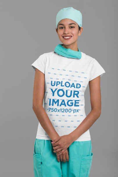 Mockup of a Smiling Female Nurse Wearing a Tee and a Hair Cap 27479