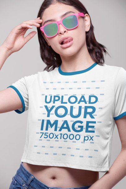 Ringer Tee Mockup Featuring a Woman with Sunglasses Taking out Her Tongue 27180